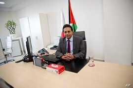 FILE - Palestinian cell phone provider Wataniya CEO Durgham Maraee speaks during an interview with the Associated Press at his office in the West Bank city of Ramallah, Jan. 10, 2018.