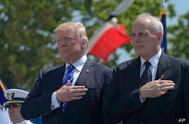 President Donald Trump and Homeland Security Secretary John Kelly, right, listen to the national anthem during commencement exercises at the U.S. Coast Guard Academy in New London, Connecticut,  May 17, 2017.