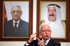 FILE - Palestinian Foreign Minister Riad al-Malki speaks during a press conference at the Palestinian embassy in Kuwait City, Kuwait, June 5, 2018.