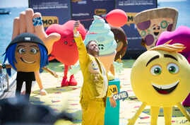 "FILE - Actor T. J. Miller poses with characters for the film ""The Emoji Movie,"" at the 70th international film festival, Cannes, May 16, 2017."