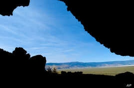 File--This July 23, 2008, photo was taken from inside the Paisley Caves near Paisley, Ore., where archaeologists found stone tools and human DNA dating back more than 13,000 years, evidence humans settled North America earlier than previously thought...