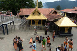 Indian Hindu devotees are pictured at the Lord Ayyappa temple at Sabarimala in the southern state of Kerala, Oct. 18, 2018.