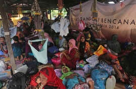 Earthquake survivors rest at a temporary shelter in Pidie Jaya, Aceh province, Indonesia, Dec. 8, 2016.