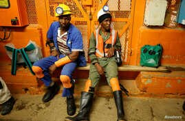 FILE - Miners take a break in a waiting area deep underground at Sibanye Gold's Masimthembe shaft in Westonaria, South Africa, April 3, 2017.