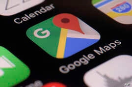 This photo taken March 22, 2017, shows the Google Maps app on a smartphone in New York. Google is enabling users of its digital mapping service to allow their movements to be tracked by friends and family in the latest test of how much privacy people