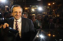 Leader of the New Democracy conservative party Antonis Samaras leaves an elections kiosk after speaking to his supporters at Syntagma square in Athens, Sunday, June 17, 2012.