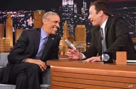 "President Barack Obama, left, shares a laugh with host Jimmy Fallon on the set of the ""The Tonight Show Starring Jimmy Fallon,"" at NBC Studios in New York, Wednesday, June 8, 2016."