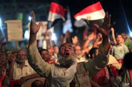 A supporter of Egypt's ousted President Mohammed Morsi chants slogans during a protest outside Rabaah al-Adawiya mosque, where protesters have installed a camp and hold daily rallies at Nasr City in Cairo, Egypt, Aug. 4, 2013.