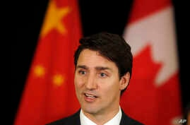 FILE - Canadian Prime Minister Justin Trudeau speaks to the media at a Beijing hotel, during a trip to China, Dec. 5, 2017.