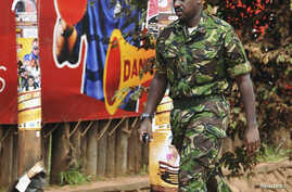 FILE - Muhoozi Kainerugaba, a son of Uganda's President Yoweri Museveni, is pictured in Kampala July 12, 2010. Kainerugaba was officially decorated following his promotion to major general Wednesday in Kampala.