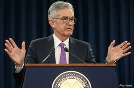 FILE - Federal Reserve Chairman Jerome Powell holds a press conference in Washington, U.S., Jan. 30, 2019.