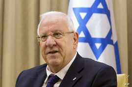 FILE - Israel President Reuven Rivlin attends a meeting at the President's residence in Jerusalem, Nov. 3, 2014.