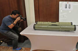 A picture taken on June 19, 2018 in Abu Dhabi shows Iranian-made anti-tank missiles which the Emirati armed forces say were used by Huthi rebels in Yemen in battles against the coalition forces led by the UAE and Saudi Arabia.