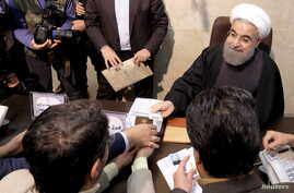 Iranian President Hassan Rouhani registers for February's election of the Assembly of Experts, the clerical body that chooses the supreme leader, at the Interior Ministry in Tehran, Dec. 21, 2015.
