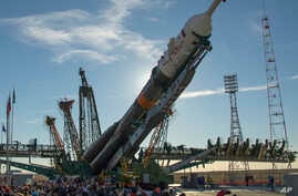 The Soyuz rocket is raised into a vertical position on the launch pad, Oct. 9, 2018 at the Baikonur Cosmodrome in Kazakhstan.