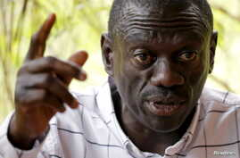 Opposition leader Kizza Besigye speaks during a news conference at his home at the outskirts of Kampala, Uganda, Feb. 21, 2016.