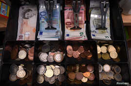 A shop cash register is seen with both sterling and euro currency in the till at the border town of Pettigo, Ireland, Oct. 14, 2016.
