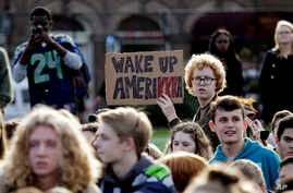 Students look on during a walkout from classes to protest the election of Donald Trump as president, Nov. 14, 2016, in Seattle, Washington.
