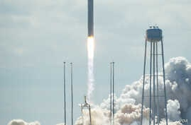 The Orbital Sciences Corporation Antares rocket, with the Cygnus cargo spacecraft aboard, is seen as it launches from Pad-0A of the Mid-Atlantic Regional Spaceport (MARS), Sept. 18, 2013, NASA Wallops Flight Facility, Virginia.
