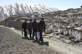 FILE - Polling officers carry Electronic Voting Machines (EVM) to a polling station in the northern Indian state of Himachal Pradesh, May 12, 2009.