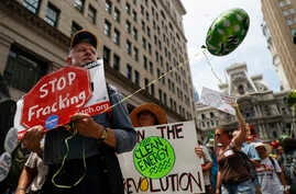 Climate change activists march in downtown Philadelphia ahead of the Democratic National Convention, July 24, 2016.