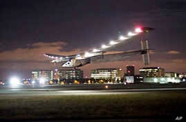 FILE - In this April 23, 2016 file photo, Solar Impulse 2 lands at Moffett Field in Mountain View, Calif., completing the leg of its journey from Hawaii in its attempt to circumnavigate the globe.