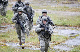 FILE - U.S. Army soldiers train during an exercise at the Adazi Training Area, Latvia, Oct. 20, 2010.