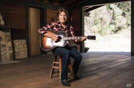 """Musician John Fogerty poses for a portrait during an interview about his new memoir """"Fortunate Son: My Life, My Music,"""" in Topanga, California, Sept. 24, 2015."""