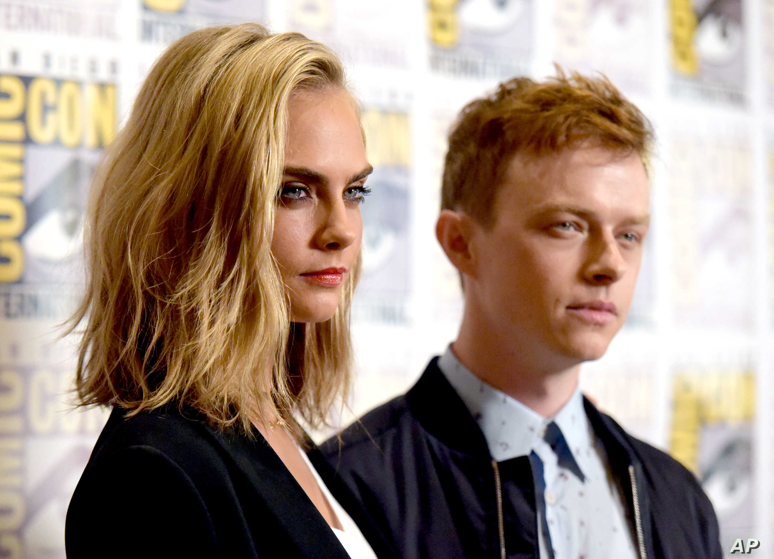 """Cara Delevingne and Dane DeHaan attend the """"Valerian and the City of a Thousand Planets"""" press line on Day 1 of Comic-Con International in San Diego, July 21, 2016."""