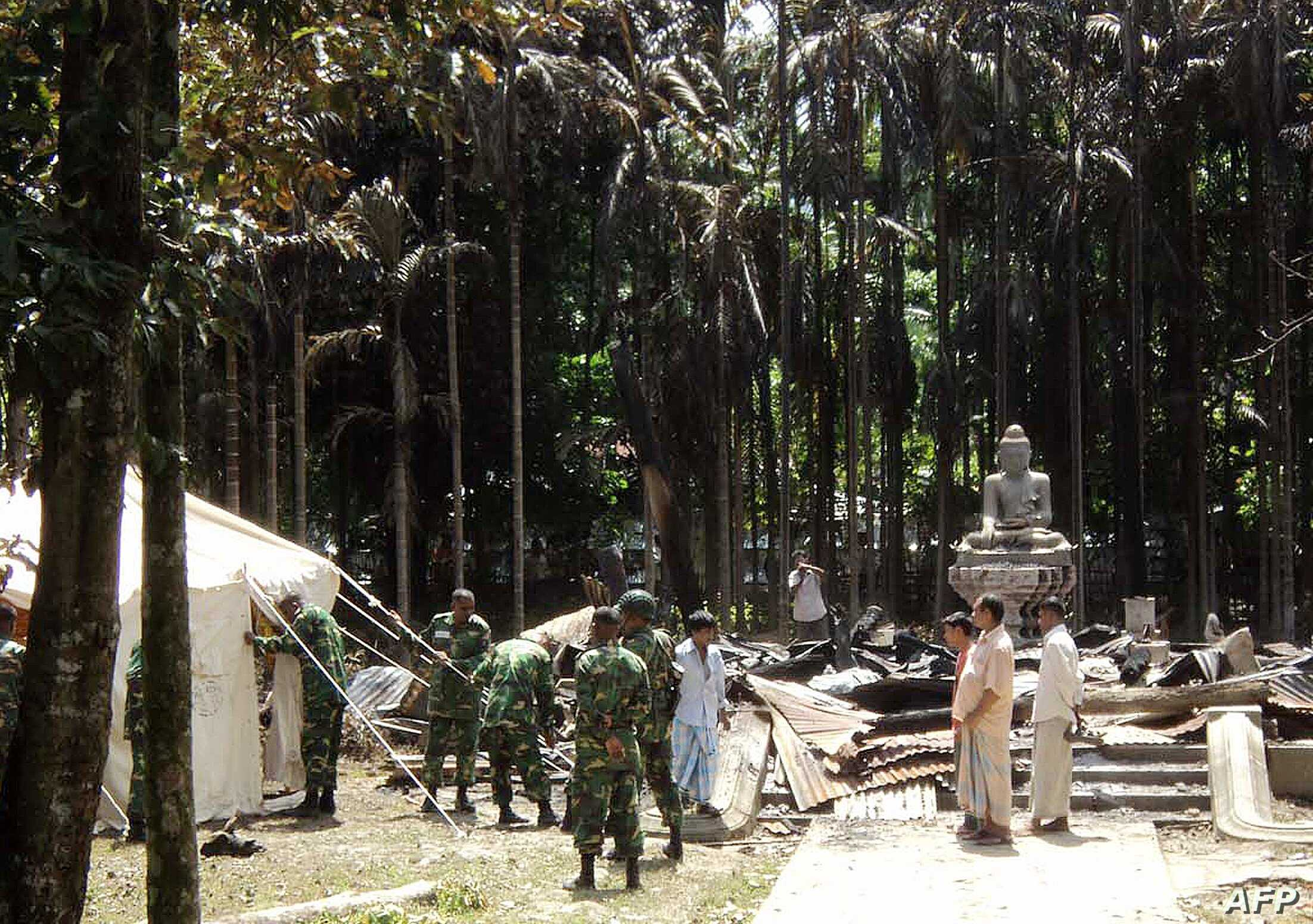 Soldiers from the Bangladesh Army erect tents at the torched Lal Ching Buddhist temple at Ramu, some 350 kilometres (216 miles) from the capital Dhaka, October 1, 2012.