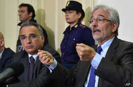 Italian prosecutor Giovanni Salvi, right, speaks during a press conference in Catania, Sicily, Southern Italy, May 19, 2015.