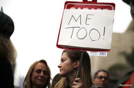People participate in a protest march for survivors of sexual assault and their supporters in the Hollywood section of Los Angeles, California, Nov. 12, 2017.