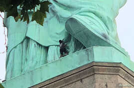 A protester is seen on the Statue of Liberty in New York, New York, July 4, 2018 in this picture obtained from social media. (Danny Owens/via Reuters)