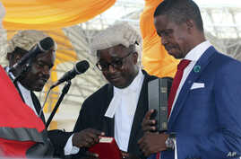 The Patriotic Front's Edgar Lungu, right, is sworn in as president at an inauguration ceremony in Lusaka, Jan. 25, 2015.
