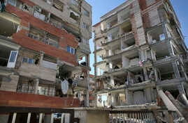 Buildings are damaged by an earthquake in a compound which was built under the Mehr state-owned program, in Sarpol-e-Zahab in western Iran, Nov. 14, 2017.