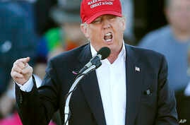 FILE - In this Feb. 28, 2016, file photo, Republican presidential candidate Donald Trump speaks during a rally in Madison, Ala.
