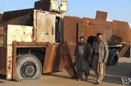 Kurdish Peshmerga commanders display on Dec. 23, 2015, heavily-fortified military equipment seized from IS during earlier battles.