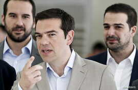 Greek Prime Minister Alexis Tsipras gestures during his visit at the Ministry of Culture, Education and Religious Affairs in Athens, June 2, 2015.