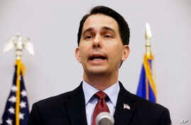 Wisconsin Gov. Scott Walker speaks at a news conference in Madison, Wis., where he announced that he is suspending his Republican presidential campaign, Sept. 21, 2015.
