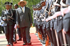 Uganda's President Yoweri Museveni inspects the nation's Honor Guard upon his arrival to deliver his state of the nation address in the capital Kampala, June 4, 2015.