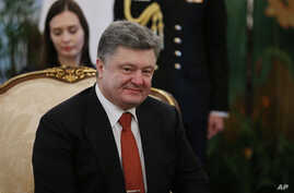 FILE - Ukraine's President Petro Poroshenko is seen in a meeting with Singapore's President Tony Tan, Tuesday, Dec. 9, 2014.