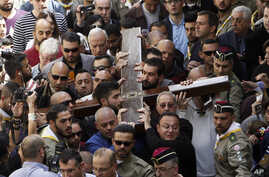 Christian faithful carry a cross during Good Friday in Jerusalem, March 25, 2016.