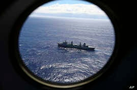 FILE - HMAS Success, as seen from a Royal New Zealand Air Force P3 Orion, patrols the Indian Ocean searching for the missing Malaysia Airlines Flight 370 off the coast of Western Australia, March 31, 2104..