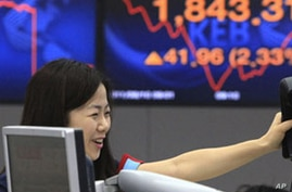 Asian Stocks Claw Back From from Opening Bell Panic