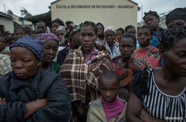 FILE - Victims of the Cyclone Idai are pictured in Beira, Mozambique, March 16, 2019.