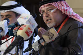 """Bahrain's Minister of Justice and Islamic Affairs Shaikh Khalid bin Ali al-Khalifa speaks during a press conference in the capital Manama, Nov. 23, 2018. Amnesty International is """"gravely concerned"""" by Bahrain's suppression of political opposition, a"""