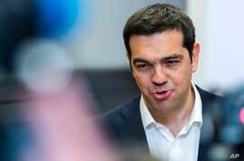 FILE - Greek Prime Minister Alexis Tsipras speaks during a media conference at an EU summit in Brussels on Monday, June 22, 2015.