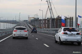 Cars drive along a bridge, which was constructed to connect the Russian mainland with the Crimean peninsula across the Kerch Strait, May 16, 2018. Russia annexed Crimea from Ukraine in 2014.