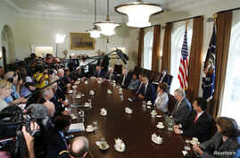 U.S. President Barack Obama (5th R) speaks at a meeting with bipartisan Congressional leaders in the Cabinet Room at the White House in Washington while discussing a military response to Syria, September 3, 2013.