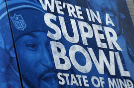 A billboard is displayed along Super Bowl Boulevard in Times Square in New York, Jan. 31, 2014.